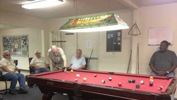 People stay cool and play pool at the Yuba City Senior Center, which will become a cooling center for all tonight at 8 (Aug. 9, 2012).