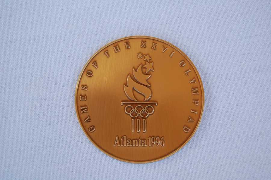 A gold memento medal from the 1996 Atlanta Games.