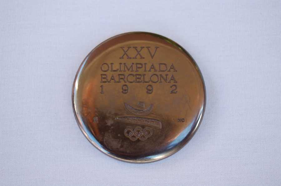 A silver 1992 memento medal from Barcelona.