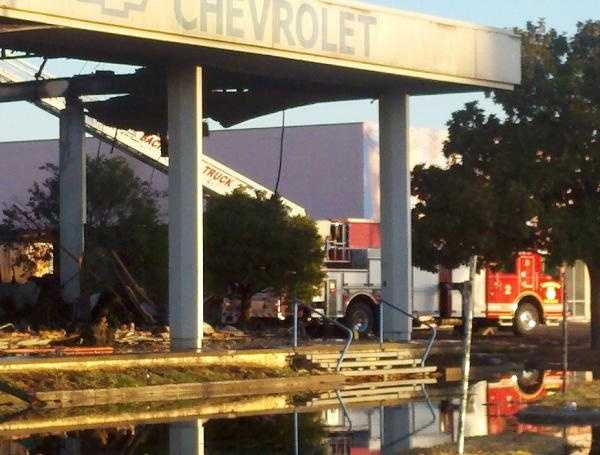 Sacramento fire crews continued to battle a fire early Friday morning at the site of a once-prominent car dealership in south Sacramento that may have been started under suspicious conditions.