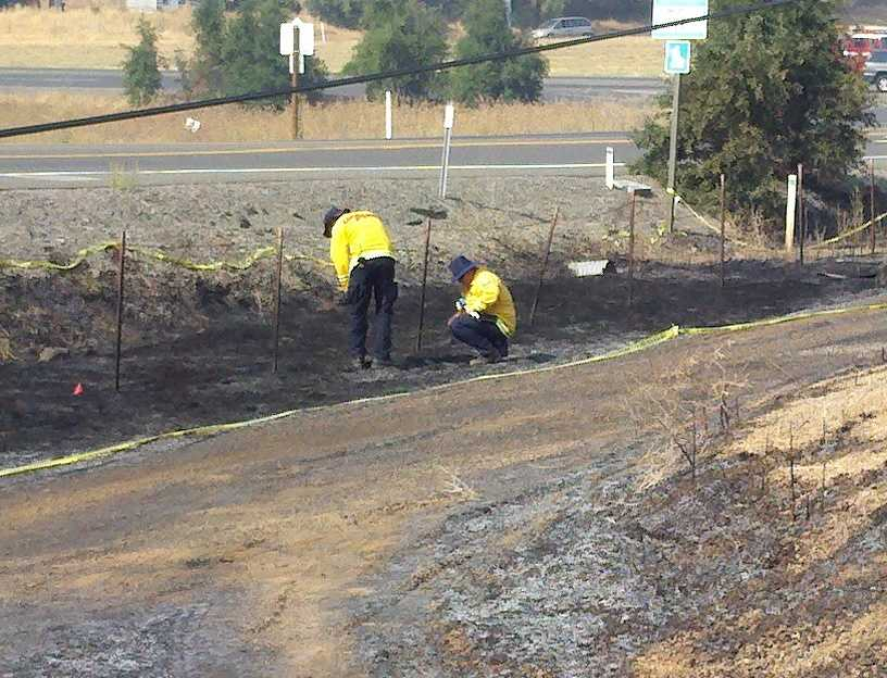Investigators look closely at the fire scene (Aug. 13, 2012).