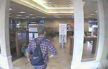 A suspected bank robber, seen in these surveillance still, was later shot to death by an officer Tuesday. Read full story