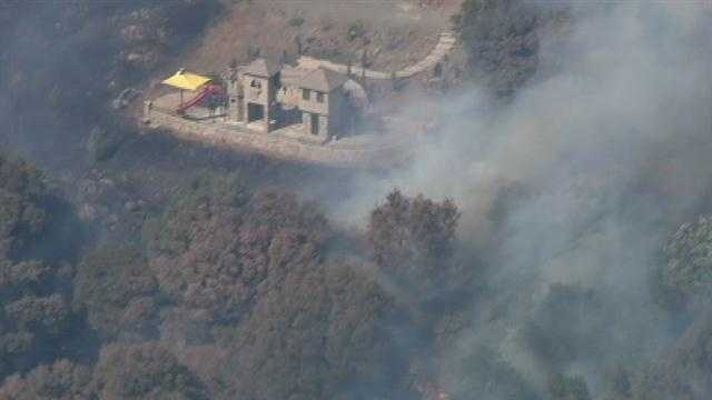 Crews battled a 25-acre fire in El Dorado County that posed a risk to nearby homes Wednesday.