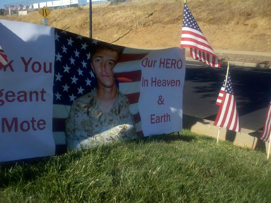 Hundreds of mourners, family and friends line up along El Dorado Hills Boulevard to remember fallen marine Sky Mote on Thursday.