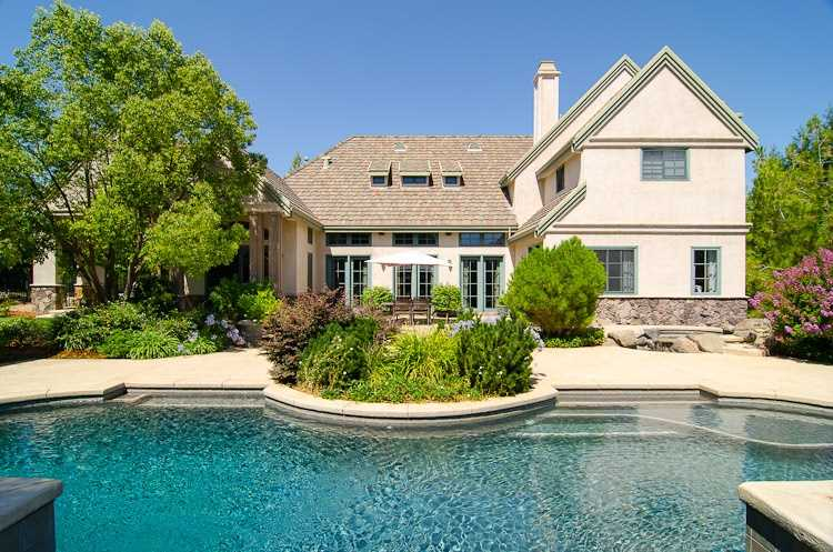 Here's a wide view of the home and pool.