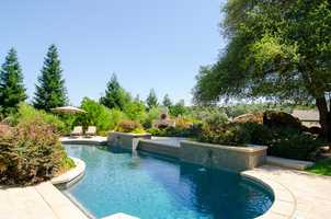 The backyard pool sparkles.