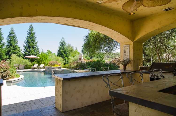 A covered patio sits right off the pool area.
