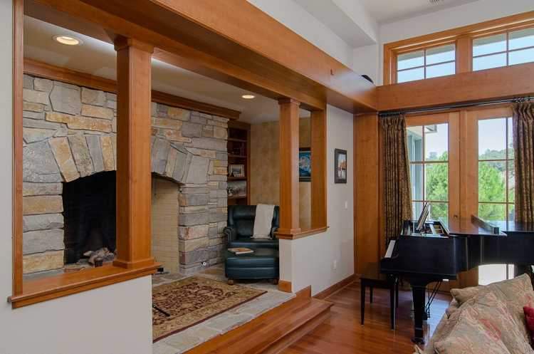 This home feature this tall fire place.