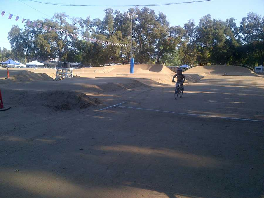 Racers of all ages prepare for a Northern California championship BMX race in Oak Creek.