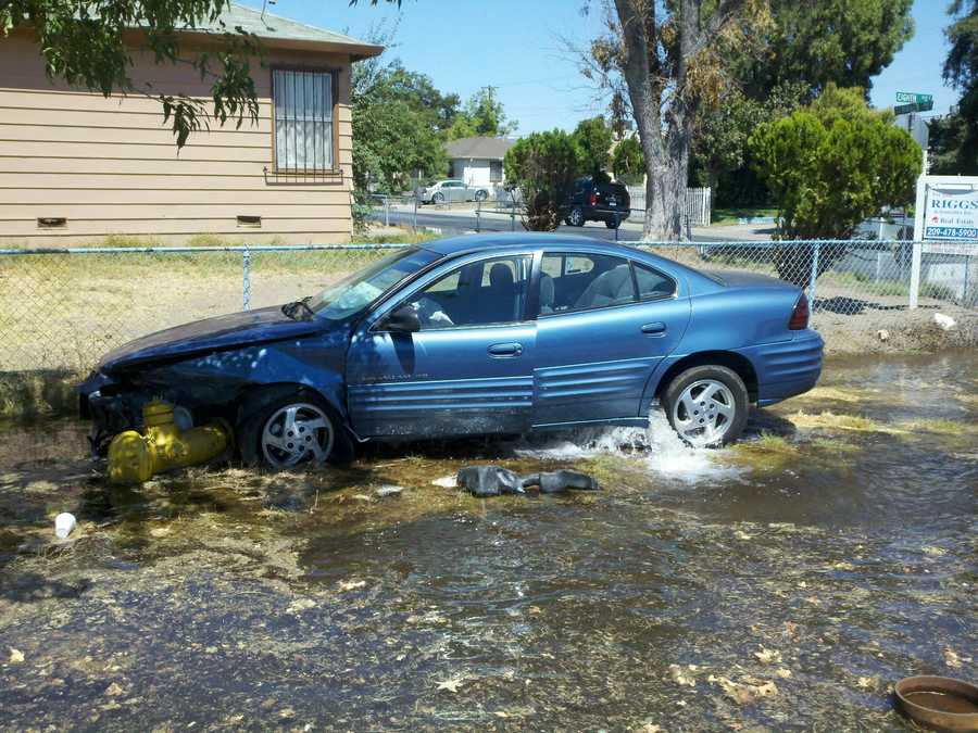 Two people were taken to the hospital after a car slammed into fire hydrant Thursday in Stockton.