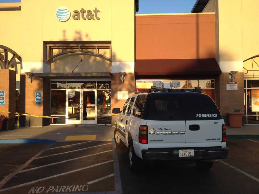 Shattered glass littered the entryways of two cellphone stores in Elk Grove that were burglarized overnight Friday.