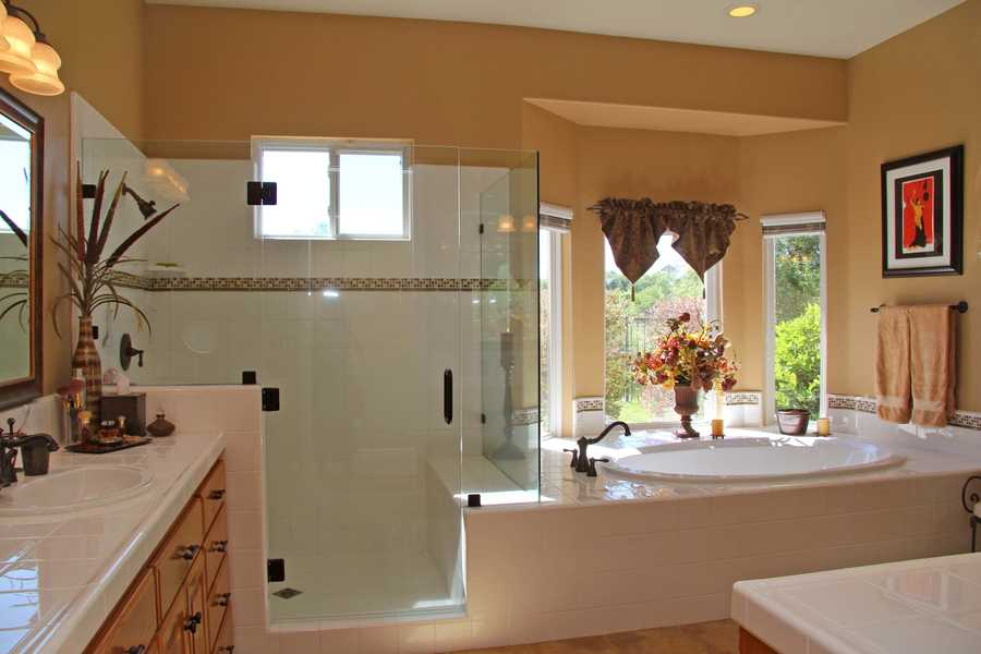 The master bathroom has plenty of room and natural light.