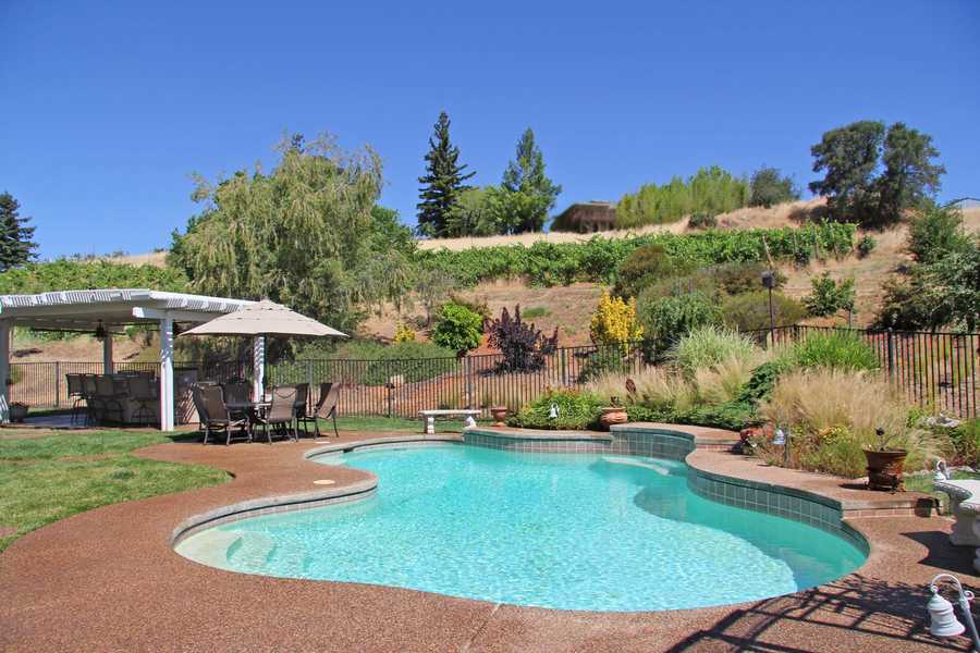 Not only does the home include a pond, but it has this sparking swimming pool.