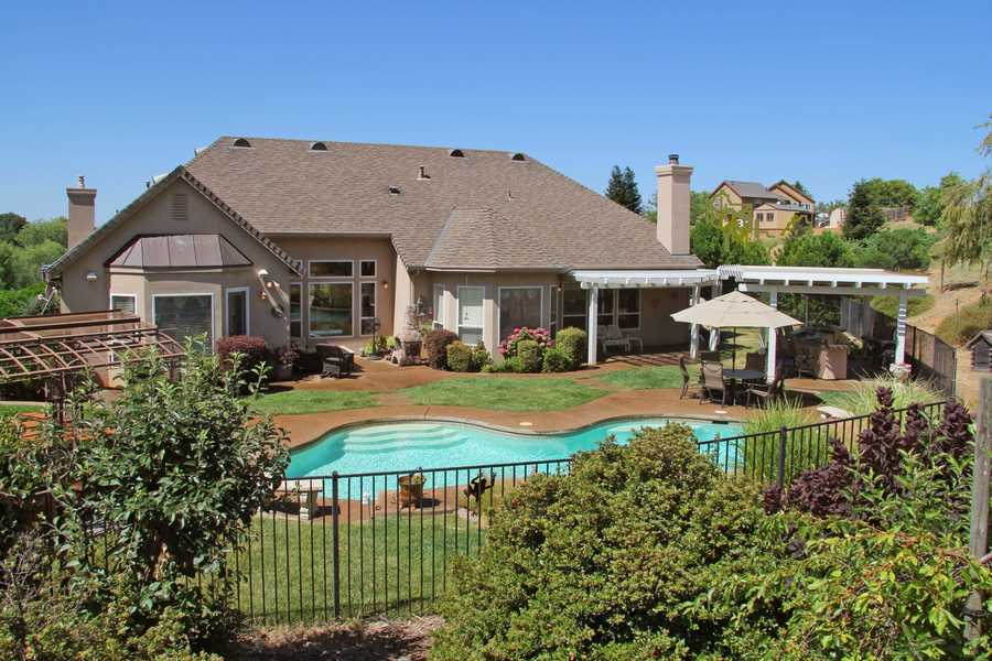 The outdoor living offers an outdoorkitchen, pool and spa and cover patios.