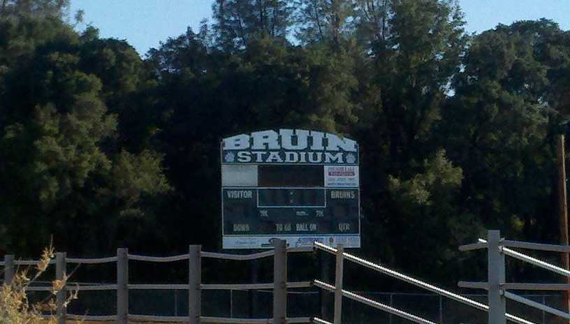The owner of an ammo shop says he paid a lot of money for a multi-year deal to post an ad, but the Ponderosa School District told him it was inappropriate. School officials removed a sign on the high school football field and the company is threatening to sue.