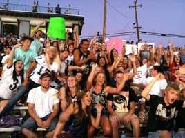 Casa fans show off their school spirit for the camera.