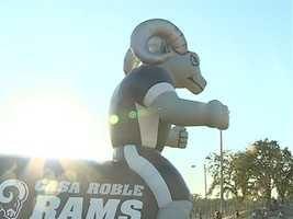 The Casa Roble mascot rolls onto the field.