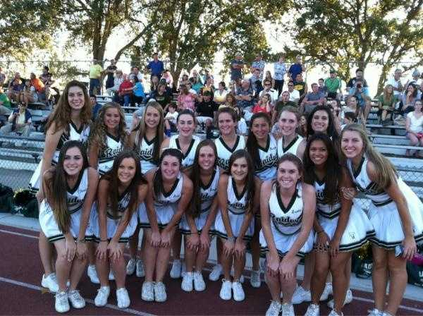The Rio cheer squad takes a moment to pause for a photo.