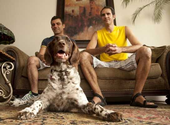 Robin Addams, left, and Tom Swierk sit with their dog Whiskey in their home in San Francisco.