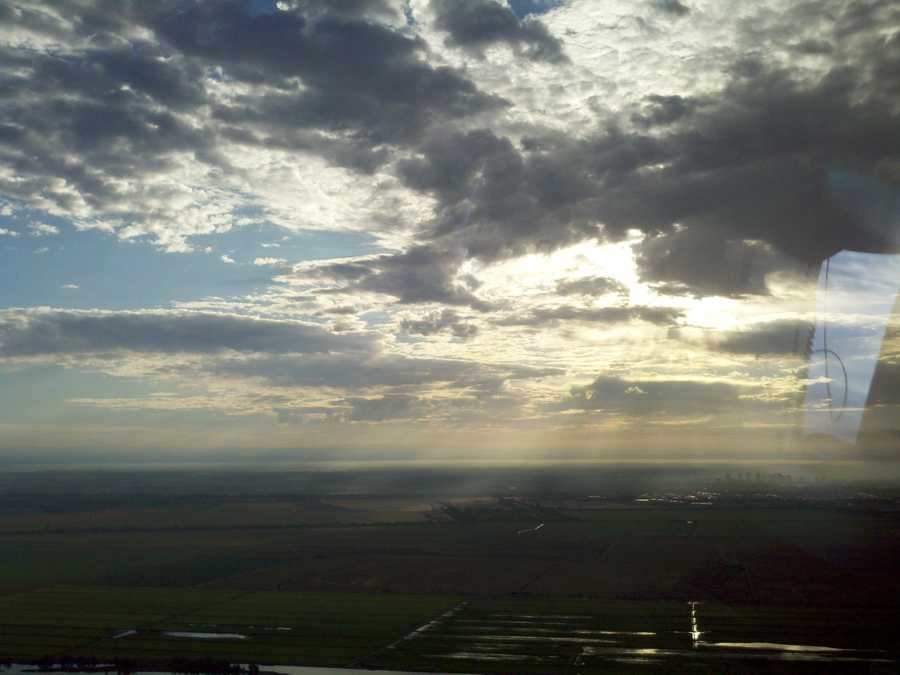 Sunshine filters through developing clouds over Sacramento.