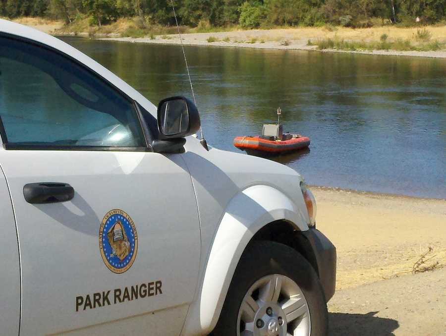 A vehicle is completely submerged Thursday into the American River just west of Sunrise Boulevard.