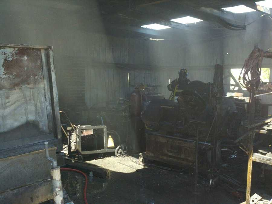 A firefighter surveys the inside of the metal shop that was destroyed in the two-alarm fire in Vacaville.