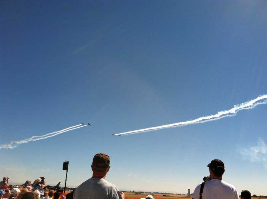 Two planesmaneuver toward each other during the air show at Mather.