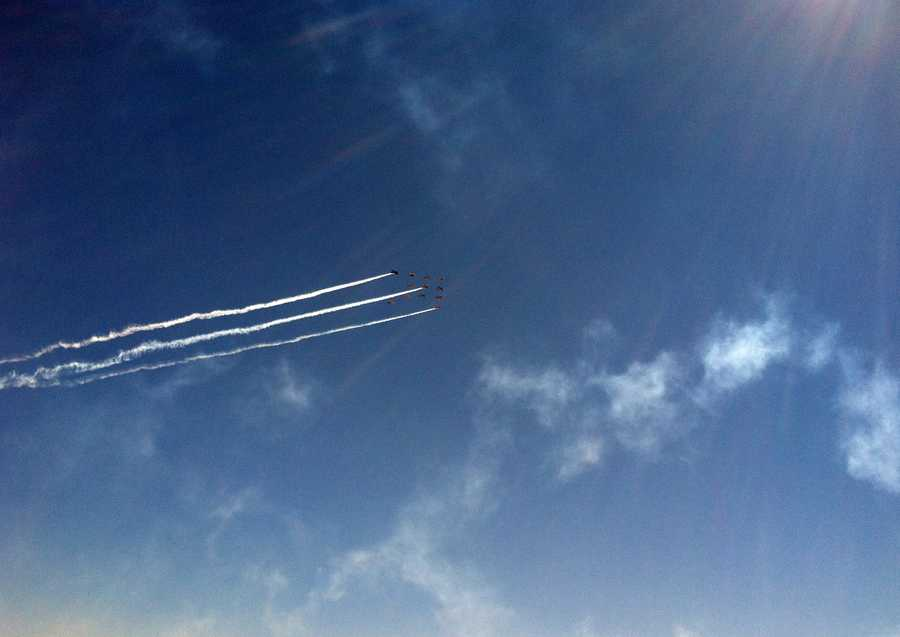 A group of planes soar above in a diamond formation on Sunday.