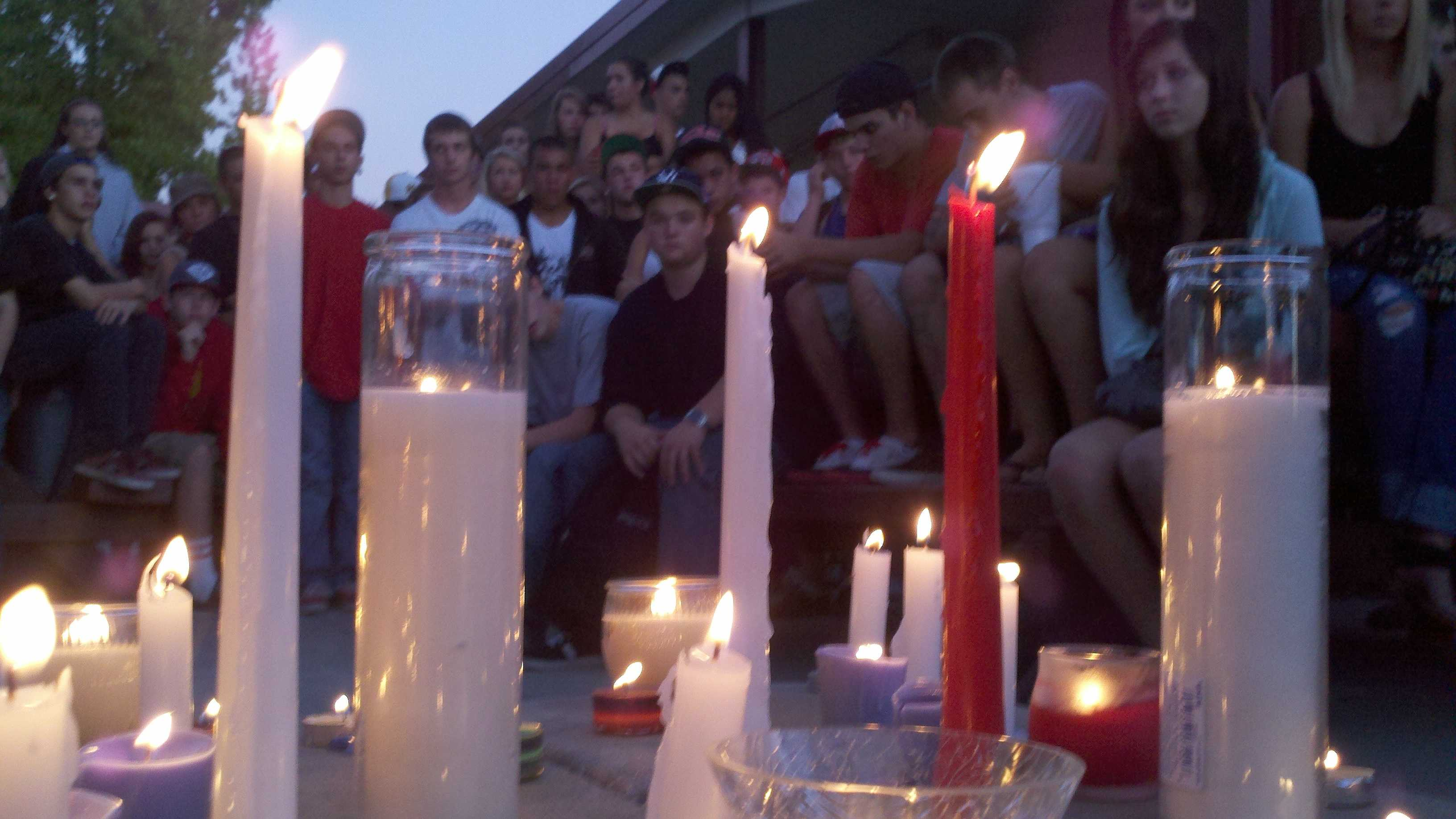 A candlelight vigil is held for the death of Alejandro Nunez Avila.