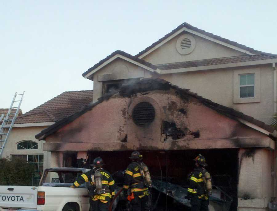 A home on Grandstaff Drive in Sacramento, and its garage, were damaged in a fire Tuesday morning. A family inside at the time escaped without injury, later telling KCRA 3 it was a smoke alarm that saved everyone from the flames.