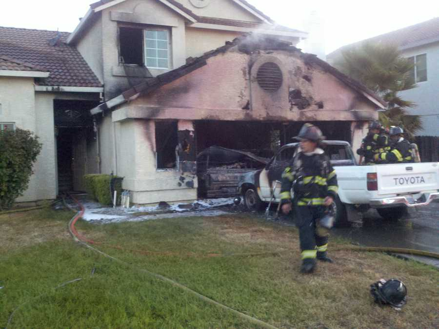 Fire officials are still investigating what caused the blaze, which appears to have sparked in the garage and spread to the home's attic.