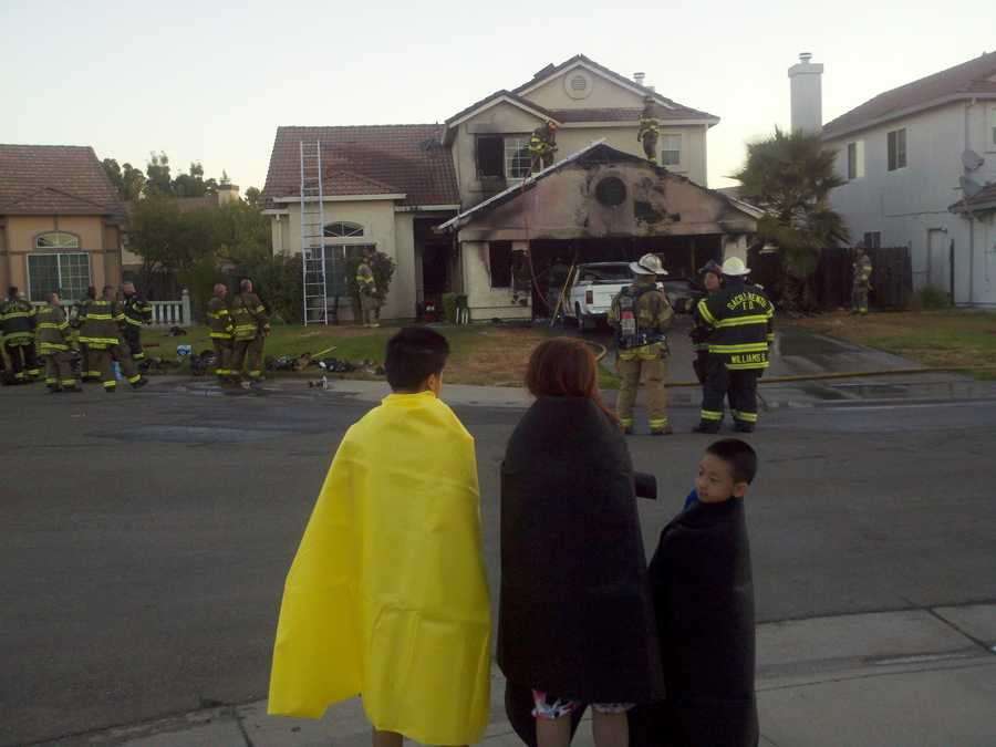 An 18-year-old was sleeping when the fire started, and credited a smoke detector with saving her family.