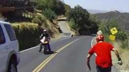 A video posted online shows a man riding a skateboard down one of the steepest roads in California.