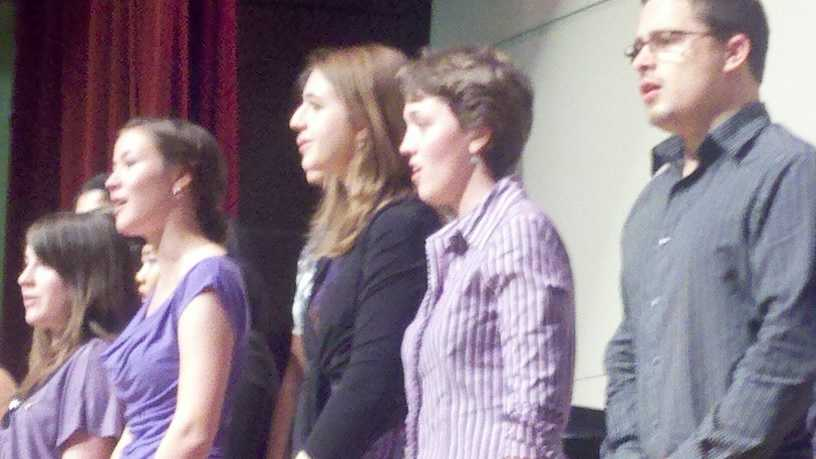 Petra Anderson, in the striped blouse, performs with members of the UOP musical fraternity.