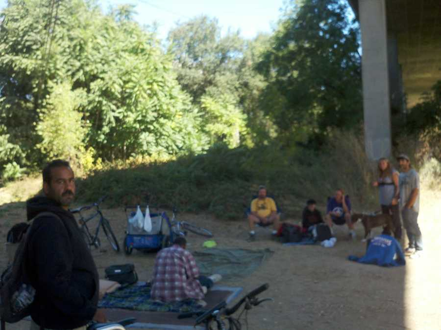 About 500 homeless people camp overnight illegally along the American River.