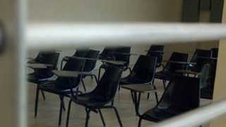 Empty chairs sit inside a classroom at charter school that closed its doors.