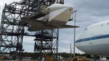 Endeavour being lifted and mounted for travel.