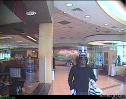 The men were seen leaving the bank in a beige Oldsmobile Cutlass with large chrome rims, police said.