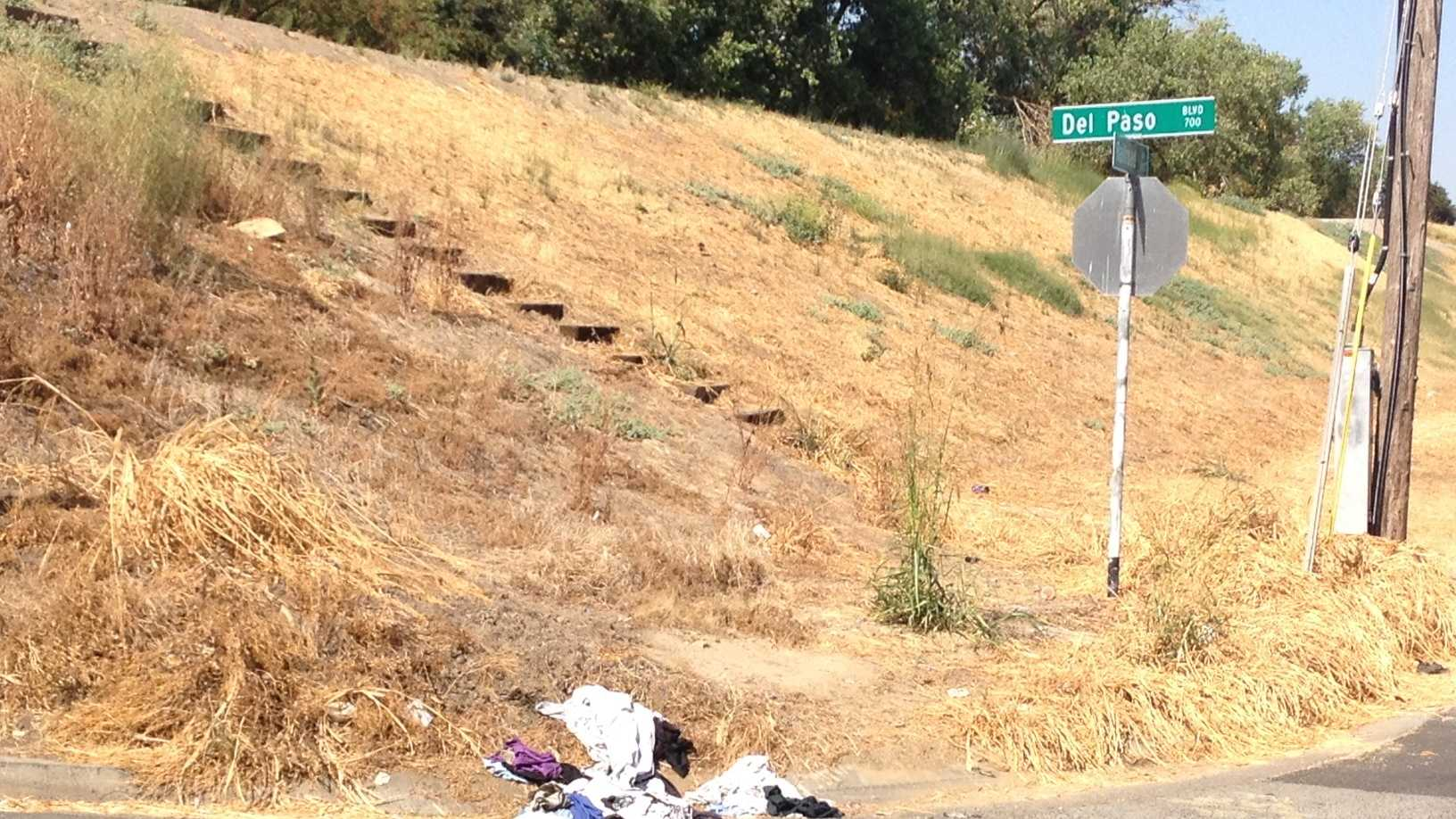 Some clothes and other items left behind by homeless are visible to drivers on Del Paso Boulevard.