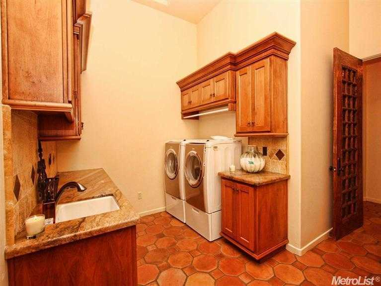 This laundry room has ample space, including countertops.