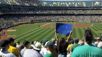 The A's, with one of the lowest payrolls in baseball, dug themselves out of a four-run deficit to stun the two-time defending league champion Rangers 12-5 Wednesday afternoon.