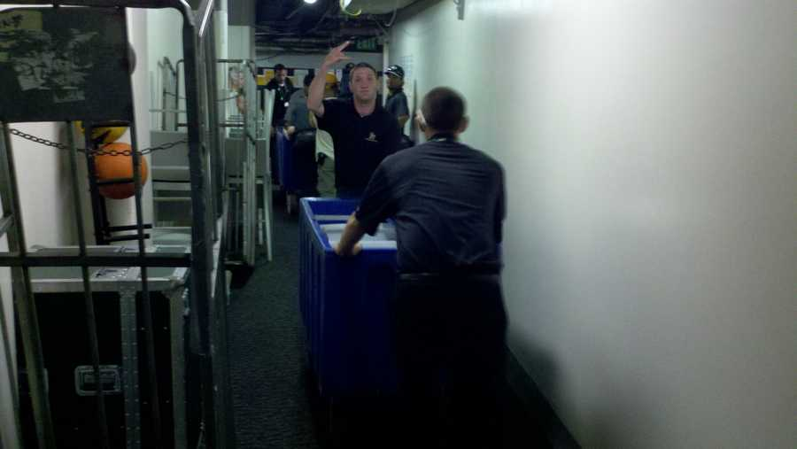 Champagne is wheeled into locker room after the A's big win.