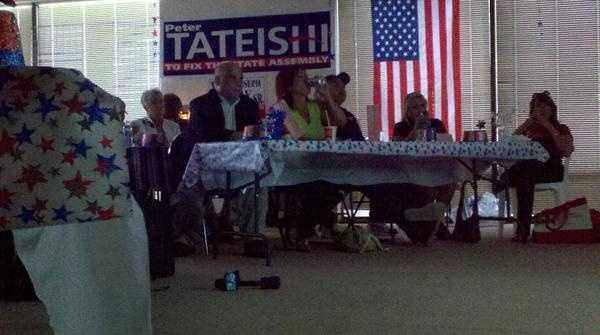 A comment about trickle down economics gets laughs and applause during a Republican watch party.