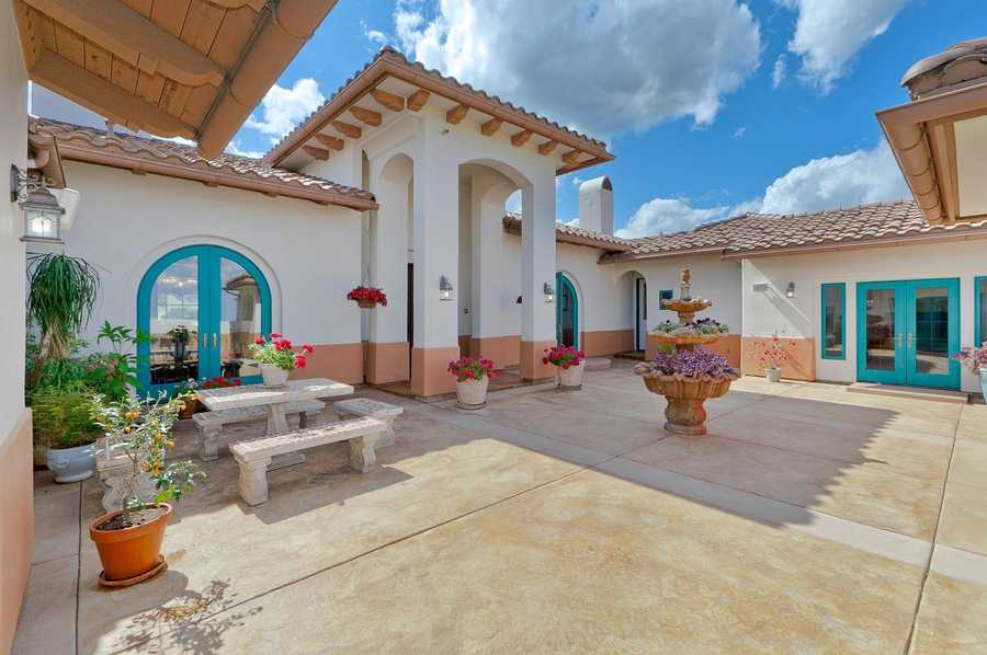 This estate has two attached casitas with full baths and exterior access.