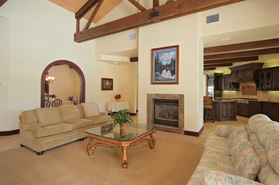 This home features vaulted, open-beam ceilings as viewed inside this family room.