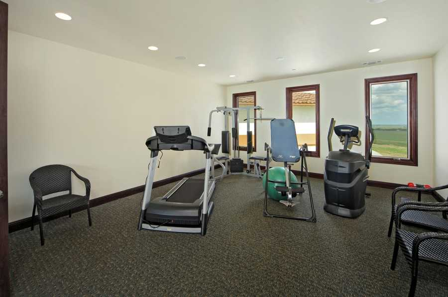 This estate includes this fitness room.