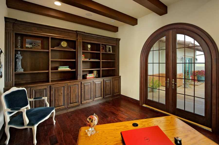 This study has built-in bookcases and double doors that open out to the front patio area.