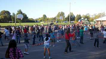 Hundreds of students at Florin Elementary School take part in hula hooping Monday.