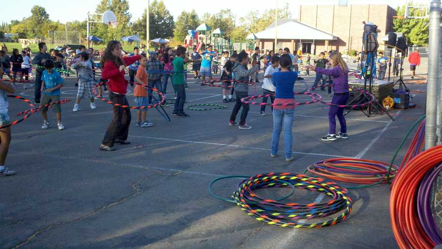 """Did you know you burn just as many calories in 10 minutes of Hula Hooping as you do when you run an eight-minute mile?"" asked Kellee McQuinn with KidTribe crew."