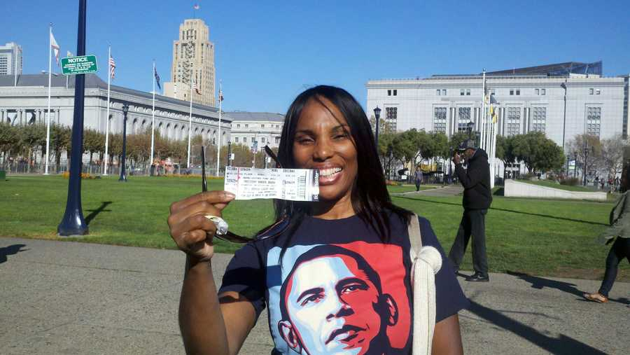 Chelle Blair, of Sacramento, holds up her ticket outside the Obama fundraiser Monday (Oct. 8, 2012).